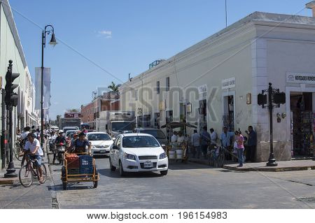 VALLADOLID YUCATAN MEXICO - FEBRUARY 24 2017: The hustle and bustle of morning traffic at a busy intersection is characteristic of the small colonial town of Valladolid