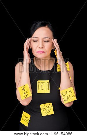 Stressed Mature Asian Woman With Sticky Notes On Clothes And Body Standing With Closed Eyes Isolated