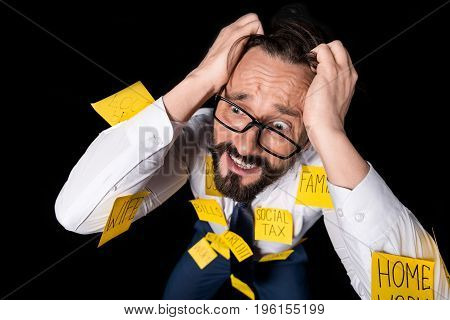 Frustrated Middle Aged Businessman With Sticky Notes On Clothes Kneeling And Tearing Hair Isolated O