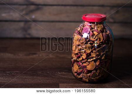 Dried fruits in a glass jar on a blurred background