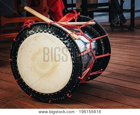 Taiko drums o-kedo on scene background. Culture of Asia Korea Japan China