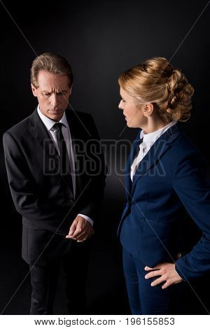 Middle Aged Business Colleagues Having Conflict And Quarreling Isolated On Black