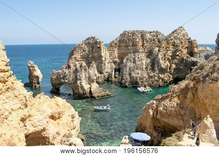 A view of beautiful sandy beach Lagos Algarve region Portugal.  Limestone cliffs Albufeira Algarve Portugal