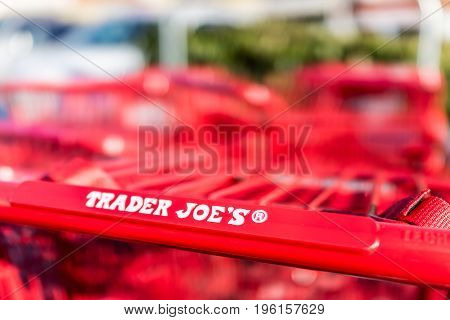 Fairfax, Usa - December 15, 2016: Red Shopping Carts With Trader Joes Store Sign On Handle