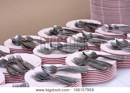Clean dishes forks and spoons for use in party.