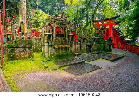 KYOTO, JAPAN - JULY 05, 2017: Mitsurugi Shrine Choja Shrine prayer area at Fushimi Inari Taisha Shrine, with a guge red door, it is a famous historic site in Kyoto, Japan.