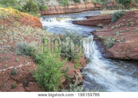 waterfalls in Park Creek at northern Colorado foothills,  summer scenery