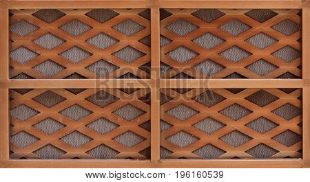 Brown wooden lath with a grid of thin strips.