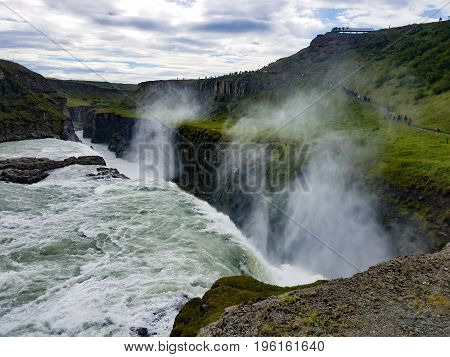 A waterfall in Iceland this some mist from the water