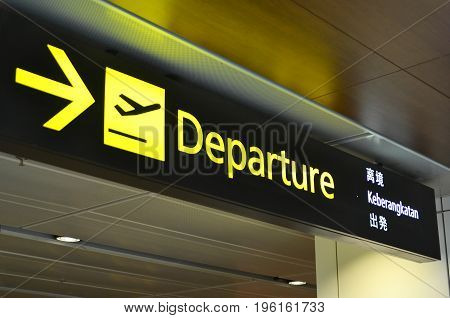 Departure Sign Hangs At Changi Airport Terminal 1