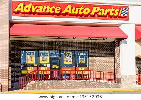 Springfield USA - December 20 2016: Advance auto parts store facade with customers