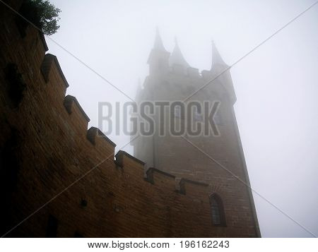 Hohenzollern castle in Swabian during autumn Germany. Castle in the mist