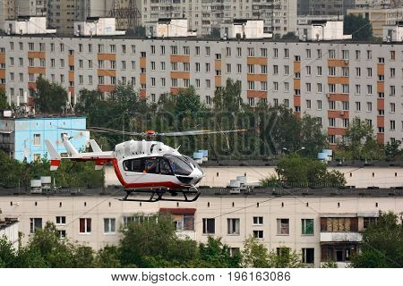 Rescue helicopter rushing to the rescue, over city
