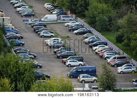 Cars in the city parking lot, top view