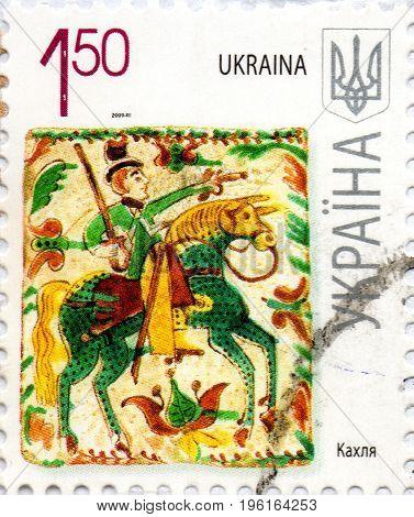 UKRAINE - CIRCA 2017: A postage stamp printed in Ukraine shows picture by ukrainian artist Fandikova tile material circa 2009