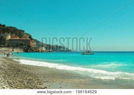 Crowded Mediterranean summer beach in City of Nice, France