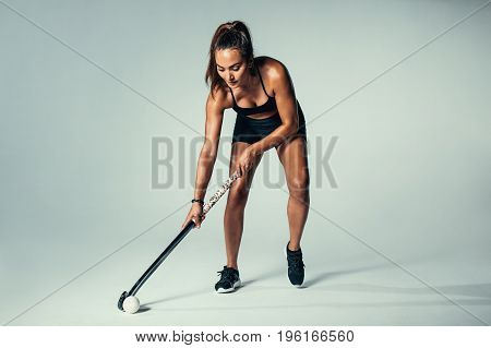 Hispanic Young Woman Playing Hockey