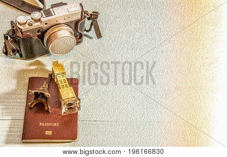 Concept Image : Camera, Eiffel Tower model, Big Ben model Passport, illustration with copy space. Travel concept, London travel, Paris Travel. Image manipulated by PS - Oil Paint -  filter effect.