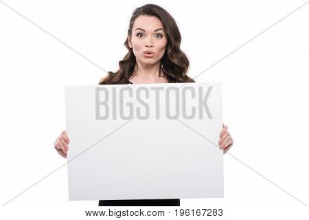 Attractive Surprised Young Woman With Blank Banner, Isolated On White
