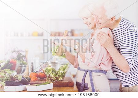 Senior Couple Making Salad
