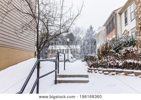 Fairfax USA - January 7 2017: Sidewalk with stairs steps in neighborhood with snow covered ground