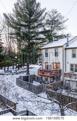 Fairfax USA - January 7 2017: Backyards in neighborhood with snow covered ground