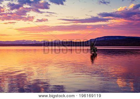 Sunrise on West Thumb Lake in Yellowstone National Park Wyoming.