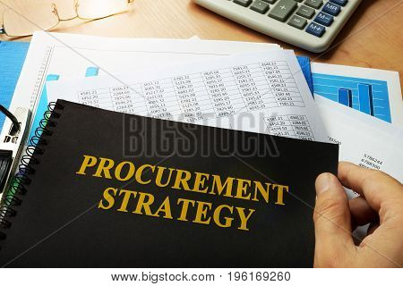 Procurement strategy written on a front of note.