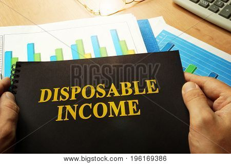 Disposable income written on a front of note.