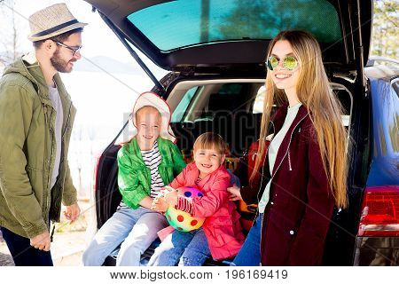 Happy family on a road trip in their car