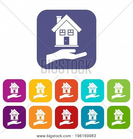 Hand holding house icons set vector illustration in flat style in colors red, blue, green, and other