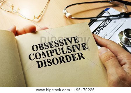 Obsessive compulsive disorder concept. Book on a table.