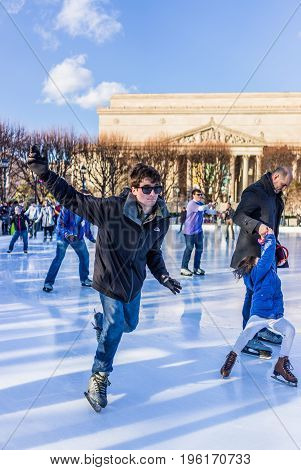 Washington Dc, Usa - January 28, 2017: Young Man Falling In Ice Rink Skating In National Gallery Of