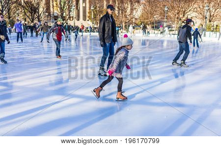 Washington Dc, Usa - January 28, 2017: Young Girl Skating In Ice Rink In National Gallery Of Art Scu