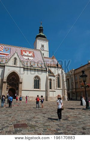 ZAGREB, CROATIA - AUG 1, 2016: : St Mark's Square in Zagreb, Croatia, surrounded by tourists. St Mark's square is political center of Croatia and popular tourist location.