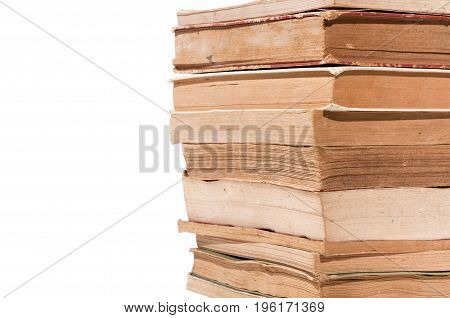 Pile of old books with yellow pages from aging isolated on white background. Selective focus.