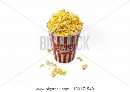 Red and white striped box of popcorn for movie isolated on a white background with clipping path ,Word of popcorn on the bucket