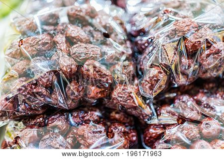 Macro Closeup Of Dried Jujubes In Plastic Wrapping