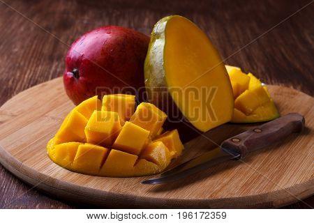 Fresh mango organic product on wooden background