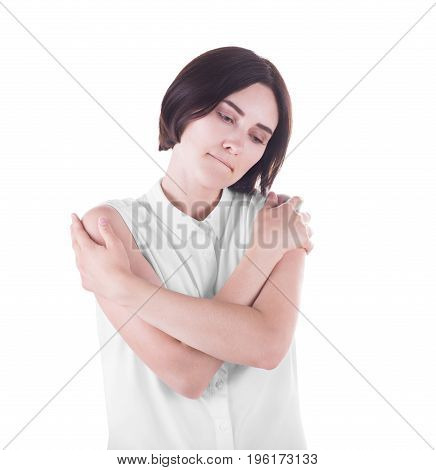 Lonely and cute tired woman deep in thoughts, isolated on a white background. A sad girl hugging herself. Loneliness, depression and sadness concept.