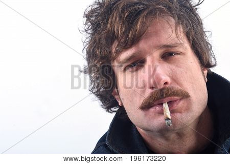 Portrait Of A Man Smoking Liar Tobacco On White Background