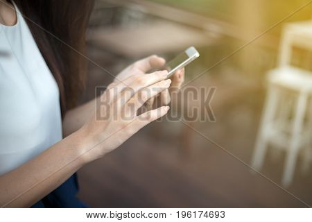 woman asian using phone for celling and texting on her mobile phone