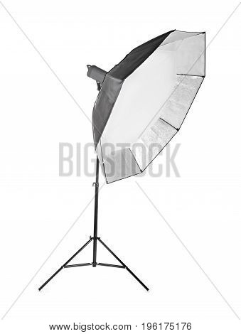 Professional studio octobox, isolated on a white background. Studio lighting. A long and black octobox. Studio equipments. Studio flash with soft-box on white background.
