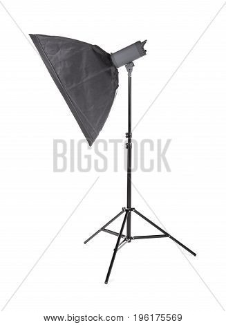 Professional studio flash with soft-box, isolated on a white background. Photo studio equipment. Pulse studio flashes with a square softbox. Outbreak.