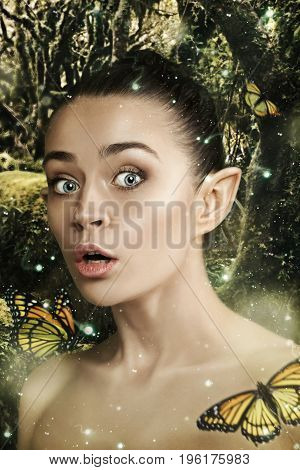 The surprised beautiful woman with green butterflys