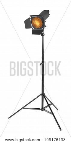 Studio lighting on a tripod stand, isolated on a white background. Spot light photography equipment. The photo of the honeycomb is glowing.