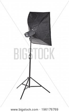 Studio lighting isolated on the white background. Professional photographic technology. A new saturated black tripod. High resolution. Photo Technique light on tripod.
