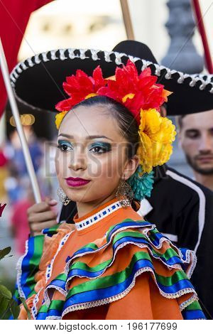 QUARTU S.E. ITALY - JULY 15 2017: 31 Sciampitta - International Folklore Festival - Sardinia (portrait of a beautiful woman of Folkloristic Ballet at the University Fuente Universidad de Coahuila - Mexico)