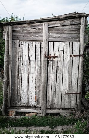 Old wooden shed in a village, grunge style