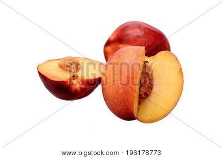 Peaches Whole And Sliced Halves With A Bone Isolated On White Background